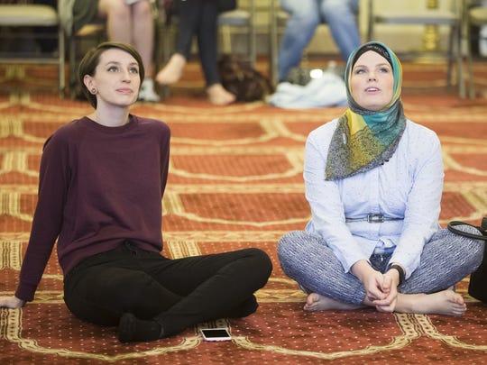 Jessica Conditt (left) and Masha Priest sit and reflect