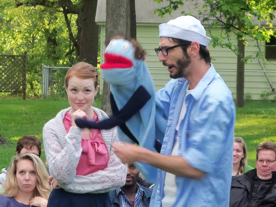 """Stone Soup Shakespeare actors Nicole Goeden, left, and Quinton Sledge perform a scene in """"As You Like It"""" using their signature puppets."""