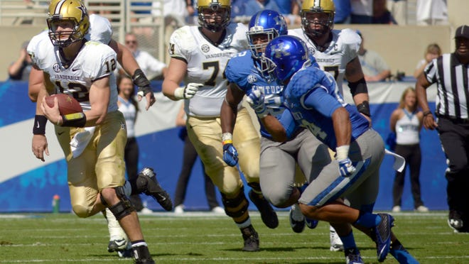 Vanderbilt quarterback Wade Freebeck breaks into the Kentucky defense during the Commodores' 17-7 loss to the the Wildcats.