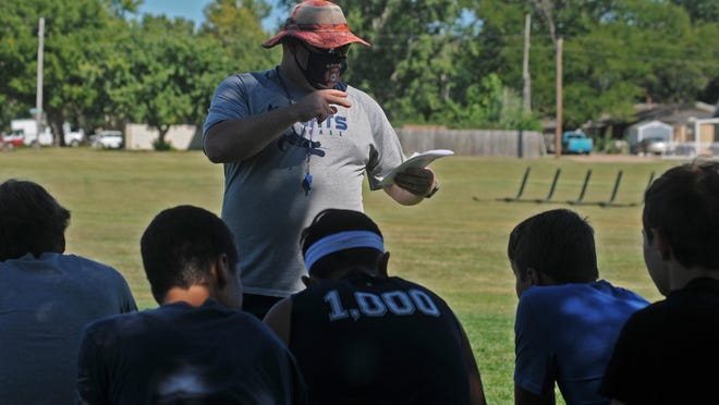 Sacred Heart head coach Shane Richards talks to his team during the first preseason practice on Monday afternoon.