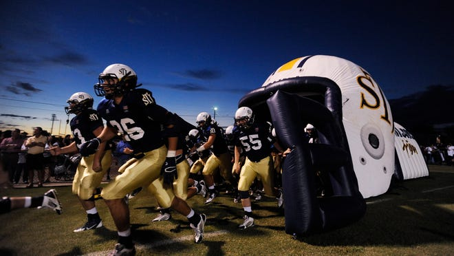 St. James  players take the field before the Park Crossing game on Friday September 26,  2014 at the St. James campus in Montgomery, Ala.