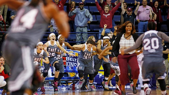 The Troy bench explodes in celebration after Troy defeated Arkansas-Little Rock during an NCAA college basketball game for the championship of the Sun Belt Conference women's tournament in New Orleans, Saturday, March 12, 2016. Troy won 61-60. (AP Photo/Max Becherer)