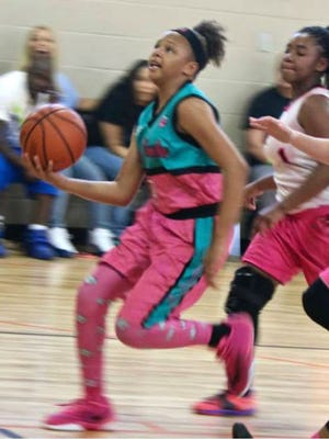 Cori Allen, 12, drives for a layup in AAU action. Allen already has received basketball scholarship offers from Middle Tennessee State and Ole Miss.
