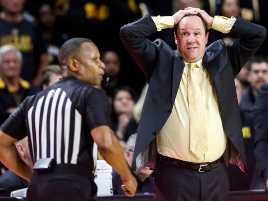 Wichita State coach Gregg Marshall, right, looks at the referee in disbelief during the first half of an NCAA college basketball game against Memphis, Thursday, Jan. 9, 2020, in Wichita, Kan. (Travis Heying/The Wichita Eagle via AP)