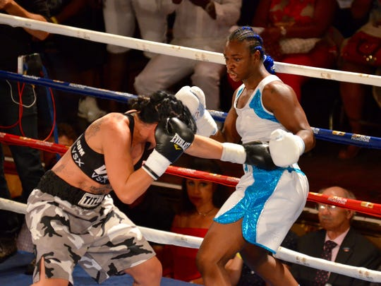 Claressa Shields, right, takes on Sydney LeBlanc in