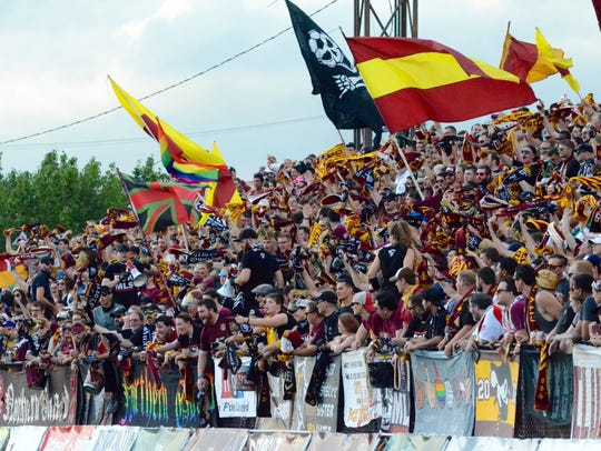 The Northern Guard, fans of the Detroit City FC, cheer