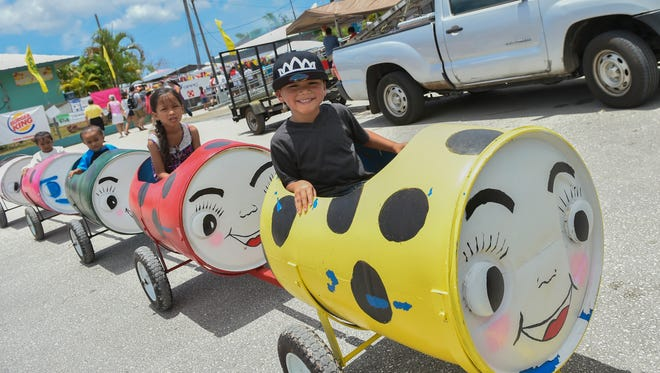 Children enjoy a ride at the 10th Annual Agat Mango Festival on May 7.