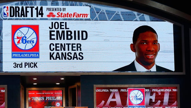 A video screen shows the selection of Joel Embiid of Kansas as the No. 3 overall pick iby the Philadelphia 76ers.