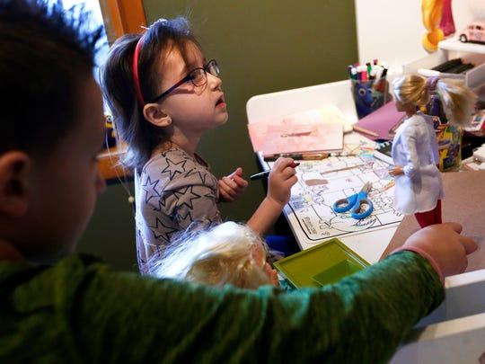 Gabriella Laubisch, age 5, and her older brother Lucas,