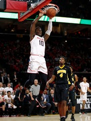 Maryland guard Darryl Morsell (10) dunks on Iowa guard