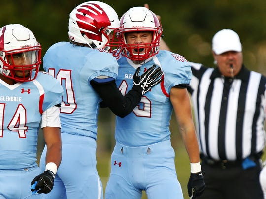 Glendale High School linebacker Carson Liston (45) and defensive back Nick Austin (10) celebrate after a defensive stop during first quarter action of the Falcons game against West Plains High School at Lowe Stadium in Springfield, Mo. on Sept. 2, 2016.