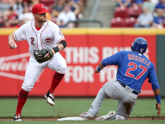 Cincinnati Reds shortstop Zack Cozart (2) throws to first to complete a double play in the first inning during the National League baseball game between the Chicago Cubs and the Cincinnati Reds on June 30, 2017 at Great American Ball Park.