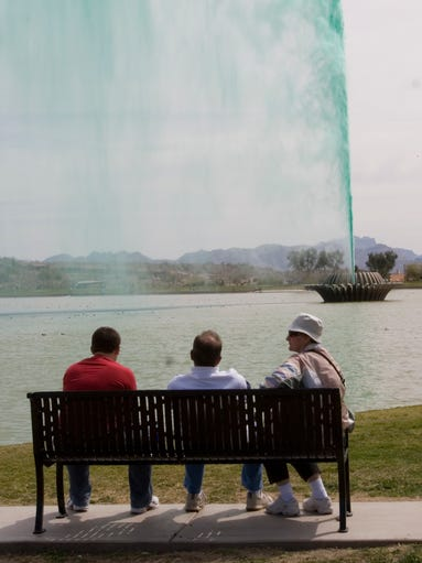 The fountain turns green at the Fountain Hills St.