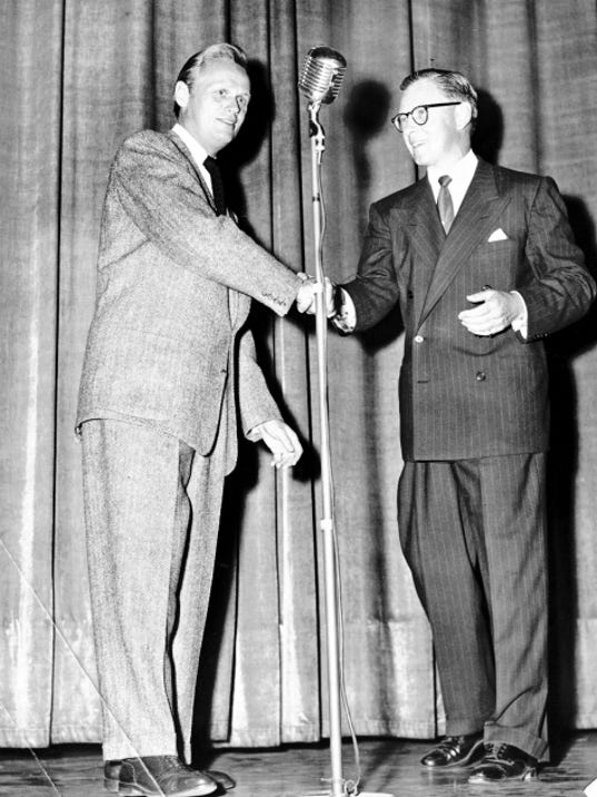 """22 SEP 1953 - CONGRATULATIONS TO STAR - From veteran Actor George Murphy, who was master of ceremonies for things over at the Plaza Monday night, goes a congratulatory handshake to Richard Widmark, star of """"Take the High Ground."""" Widmark gave audiences a sketch from """"Kiss of Death,"""" the film which made him an overnight star several years ago. (Times staff photo)"""