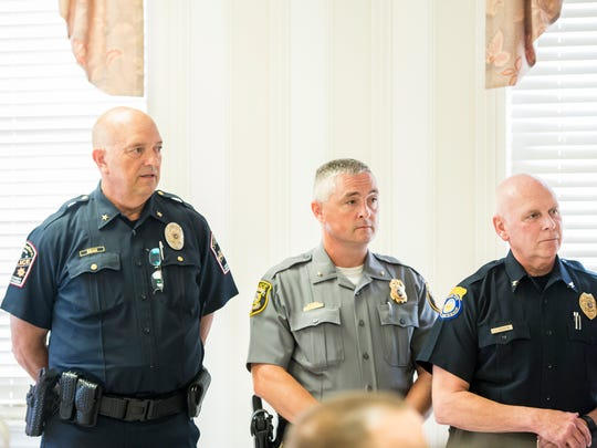 (From left) Southwestern Regional Police Chief Gregory Bean, Hanover Borough Police Chief Chad Martin and Penn Township Police Chief James Laughlin listen during a press conference hosted by Kate Klunk to promote domestic violence legislation at the Hanover YWCA on Tuesday, August 8, 2017.