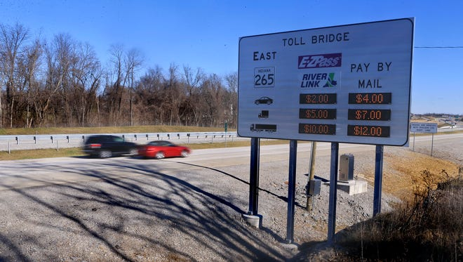 A sign displayed toll costs to traffic along the 265 in Clark County before the East End bridge loomed ahead.
