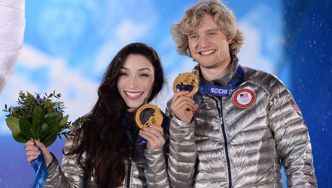 U.S.  gold medalists Meryl Davis and Charlie White pose on the podium during the Figure Skating Ice Dance Medal Ceremony at the Sochi medals plaza during the Sochi Winter Olympics on February 18, 2014.