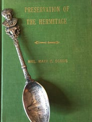A sterling silver spoon and a hardback book are two
