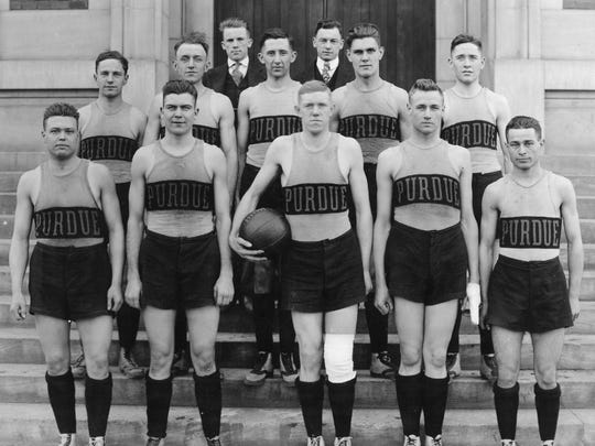"Ward ""Piggy"" Lambert, back row right, and his first Purdue basketball team in the 1916-17 season outside Memorial Gymnasium."