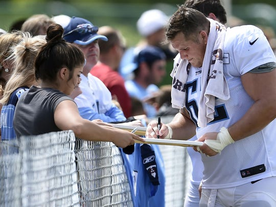 Titans center Brian Schwenke (62) signs autographs