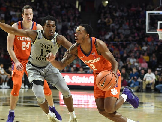Wake Forest guard Bryant Crawford (13) guards Clemson