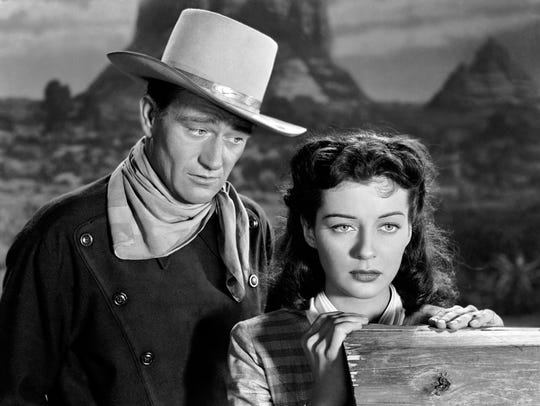John Wayne appears with Gail Russell in a scene from
