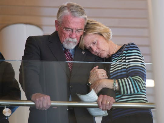 "Del. Richard P. ""Dickie"" Bell, R-Staunton, and Anne Bell bow their heads in prayer during Dennis Burnett's memorial service in Fishersville on Sunday, Oct. 26, 2014. Speaking of Burnett, Dickie Bell said, ""He was a dynamo, he was an incredible human being."""