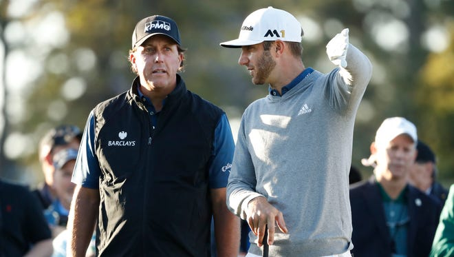 Phil Mickelson, left, is looking for his fourth Masters win, while Dustin Johnson is seeking his first major victory.