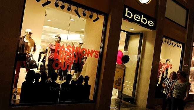 Customers walk by a Bebe store at The Forum Shops at Caesars in Las Vegas.