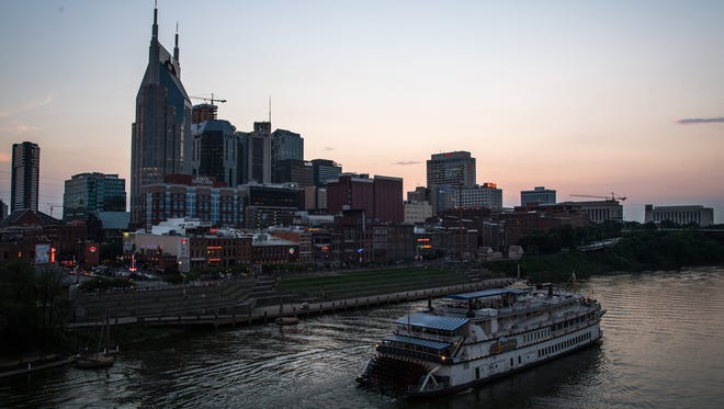 The sun sets behind the skyline in Nashville on July 19, 2017.