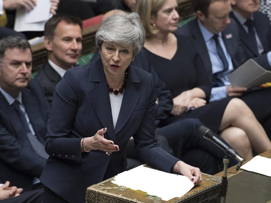 Britain's Prime Minister Theresa May talks to lawmakers inside the House of Commons parliament in London Wednesday, March 27, 2019. May offered to resign from office if her deal is passed at some point and Britain left the European Union.