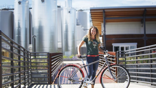 Valerie Patenotte, executive assistant to the general manager at New Belgium in Asheville, received a bicycle from the company after working there for one year. She rides the bike two to three times a week.