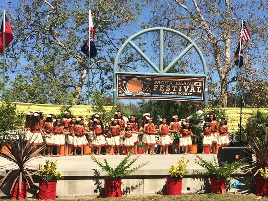 635804691562304915-Uno-Hit-and-Kutturan-Chamoru-nene-performers-on-stage-at-the-recent-festival