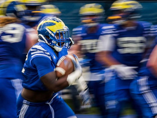 Delaware running back Kareem Williams runs through the line during a drill at during spring practices for the University of Delaware football team at the University of Delaware in Newark on Tuesday afternoon.