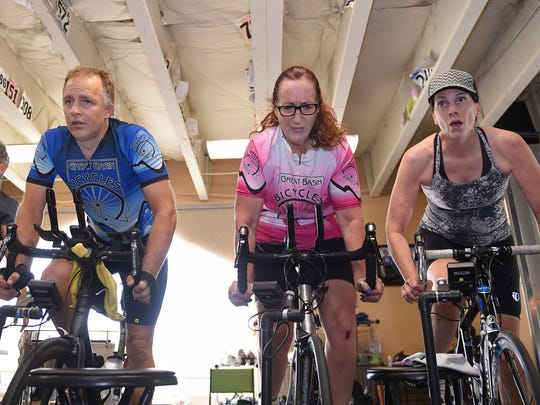 Lisa Anderson, third from the left, and classmates Leslie Duggur, far left, Rich Staley, left, and Cat Gardella, right, get a workout at a Compu-Trainer class at Great Basin Bicycles. Anderson has a bone condition that required her to have her hips replaced. Now she's training for a 100-mile cycling race.