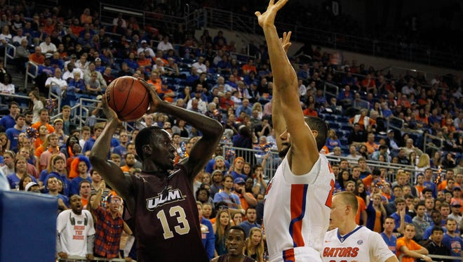 Majok Deng (13) and Justin Roberson each scored 23 points in ULM's win over Little Rock on Thursday night.