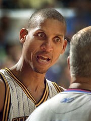 Indiana Pacers Reggie Miller questions a call by official