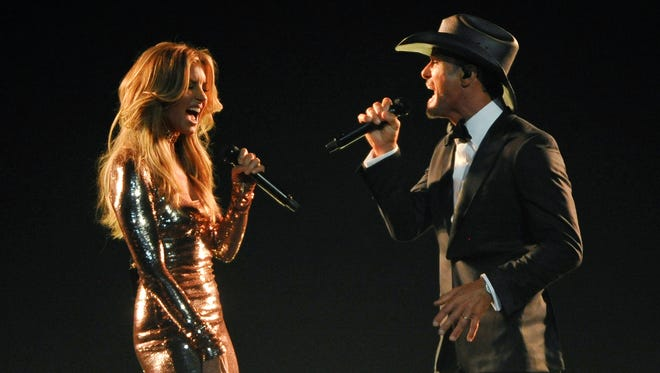Faith Hill, left, and Tim McGraw perform during the 52nd Academy of Country Music Awards at T-Mobile Arena on Sunday, April 2, 2017, in Las Vegas, Nev.