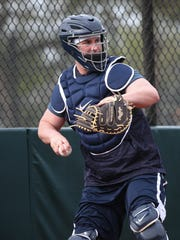 Tigers catcher James McCann goes through drills during an informal workout on Tuesday, Feb. 13, 2018, at Publix Field at Joker Marchant Stadium in Lakeland, Fla.