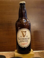 One of the key ingredients used in mixing and applying the pigment is beer. In this case, Guinness Extra Stout but it needs to be stale to work properly. Friday, July 13, 2018.