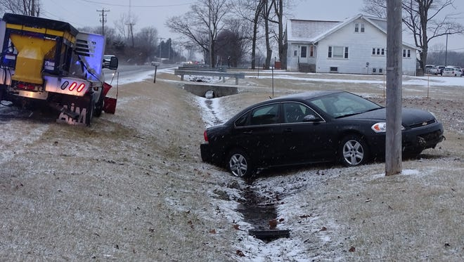 This car, at Marion Williamsport Road and Bermuda Drive, is one of several to go off the road in Wednesday evening's inclement weather.