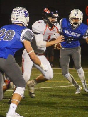 Hasbrouck Heights quarterback James Klenk (1) running through the Wallington defense en route to a 50-yard touchdown.