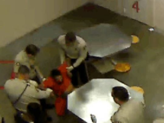 Screenshot from a video of a Riverside Jail incident that eventually left an inmate paralyzed.