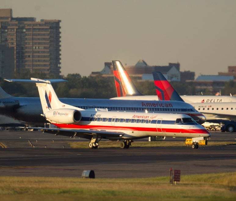 An American Eagle Embraer 135LR regional jet lands at Ronald Reagan National Airport in Arlington, Va., on Sept. 9, 2010.
