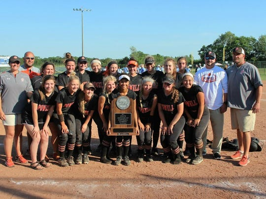 Powell High softball team members and coaches with