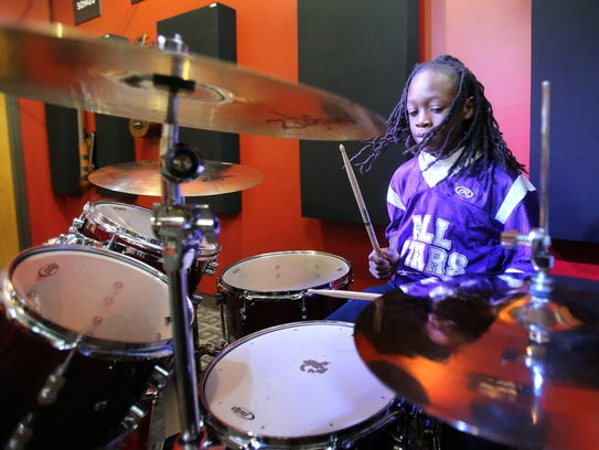 Nine-year-old Nijee Johnson plays through a set in