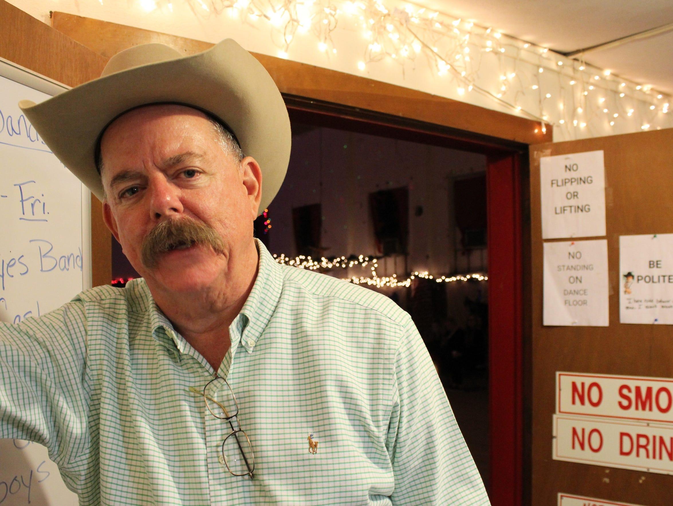 Phil Rockett, both a greeter and supervisor, talks