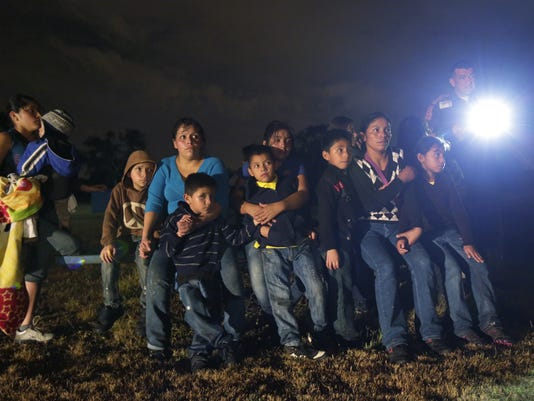 2014 401379087-Immigration_Overload_Refugee_Status_WX104_WEB000101.jpg_20140.jpg