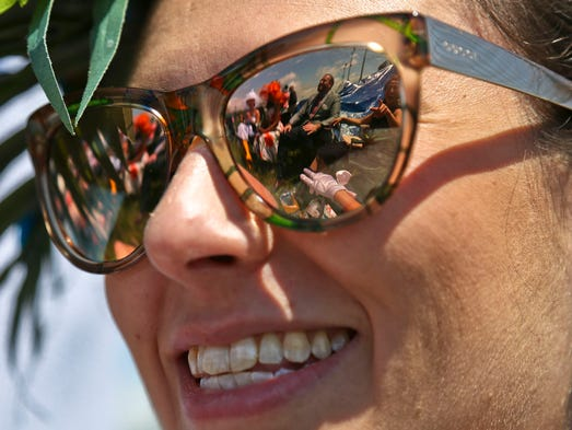Race fans from Chicago are reflected in the glasses
