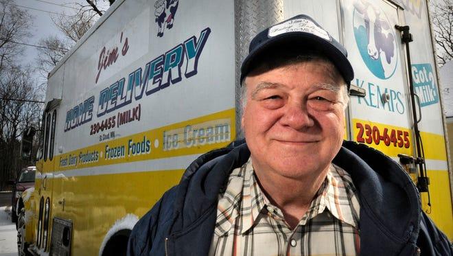 Jim Van Vooren stands next to his milk truck at his home Friday in Sartell. Van Vooren has operated Jim's Home Dairy Delivery for 14 years.